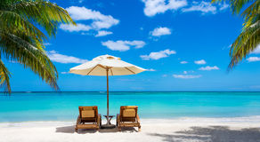 Two Deckchairs On The Idyllic White Beach Turquoise Sea Royalty Free Stock Images