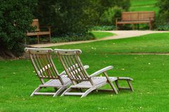 Two deckchairs in a park Stock Photography
