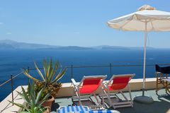 Two deckchairs on the roof. Santorini island, Greece Royalty Free Stock Image