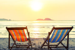 Two deckchairs on a sunny sea beach. Relax. Stock Photo