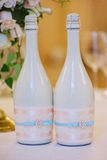 Two decorated bottles of champagne on the wedding celebration Stock Images