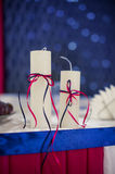 Two decorated candles blue and red style Stock Image