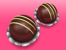 Two decorated chocolate on pink background Royalty Free Stock Photos