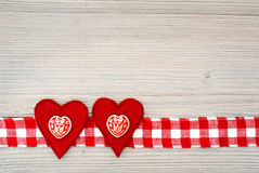 Two decorated felt hearts Royalty Free Stock Photography