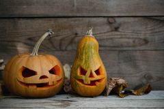 Decorated pumpkins for a Halloween on a mystical background. Two decorated pumpkins for a Halloween on a mystical background royalty free stock photography