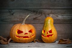 Decorated pumpkins for a Halloween on a mystical background. Two decorated pumpkins for a Halloween on a mystical background stock photography