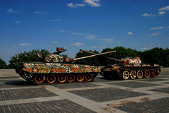 Two decorated tanks. With crossed barrels Stock Photo