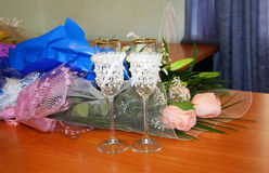 Two decorated wedding glasses and flowers Royalty Free Stock Image