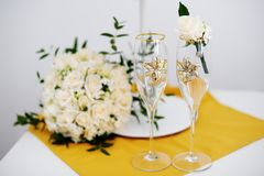 Wedding glasses and groom boutonniere Royalty Free Stock Photography
