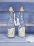 Two decorative bottles with small stones Royalty Free Stock Image