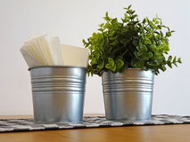 Two decorative buckets on table Stock Photos