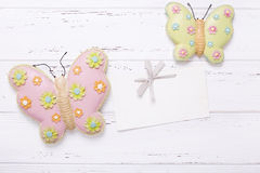 Two decorative butterflies. And empty tag  on vintage wooden background. Top view. Flat lay. Place for text Stock Photos