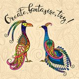 Fantastic birds 2. Two decorative fantastic birds with the inscription `Create, fantasize, try Royalty Free Stock Photo