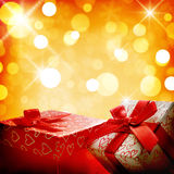 Two decorative gift boxes Golden bokeh close up Royalty Free Stock Photography