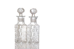 Two decorative glass vinegar carafe. Two sparky glass olive oil flagons with decorative facet structure stock photos