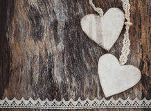 Two decorative hearts on aged wooden background.  Valentine Day concept. Royalty Free Stock Photos