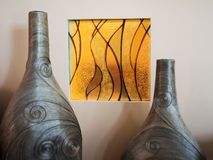Two decorative vases with yellow patterns. stock photos