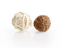 Two decorative wicker wooden balls. On a white background stock photo
