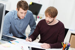 Two dedicated businessman having a meeting Royalty Free Stock Images