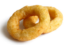 Two deep fried onion or calamari rings  on white. Royalty Free Stock Images