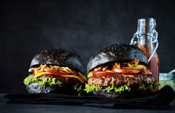 Two delicious burgers with ketchup bottle Royalty Free Stock Photo