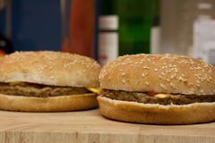 Two delicious cheeseburgers Royalty Free Stock Photography