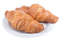 Two delicious croissants on a plate Royalty Free Stock Images