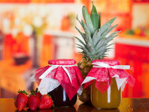 Two delicious desserts, pineapple and strawberry jam. Ready to served.  royalty free stock photography
