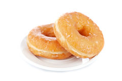 Two delicious donuts on a dish Royalty Free Stock Photo