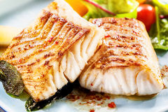 Two delicious fillets of marinated pollock Royalty Free Stock Image