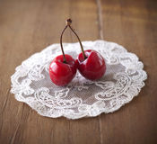 Two delicious ripe cherries Stock Images