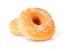 Two delicious sugared donuts. Over white background Stock Image