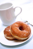 Two delicious sugared ring donuts Stock Photo