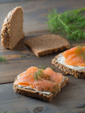 Two delicious whole wheat sandwiches with smoked salmon and slic Royalty Free Stock Photography