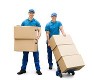 Two Delivery Men With Cardboard Boxes. On White Background Stock Photos