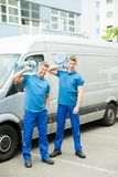 Two Delivery Men Delivering Bottles Of Water Royalty Free Stock Image