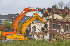 Two Demolition cranes at work Stock Photos
