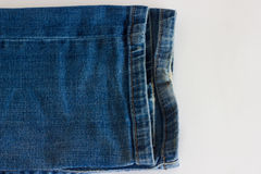 Two denim trousers. A pair of jeans sleeves close-up of blue Stock Photos
