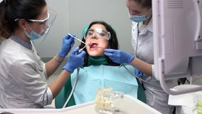 Two dental doctors at work. stock footage