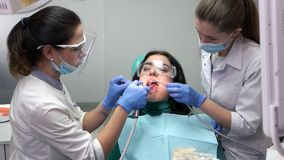 Two dental doctors working. stock video footage