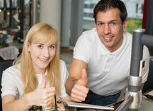 Two dental technicians showing thumbs up Stock Photography