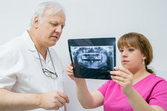 Two dentist doctor analyzing X-ray Stock Image