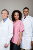 Two dentists and a dental nurse Royalty Free Stock Image
