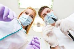 Two dentists examining teeth Royalty Free Stock Photos