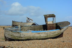 Two derelict boats. A photo of 2 abandoned boats on a beach Royalty Free Stock Images