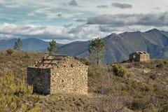 Two derelict stone buidings in Mountains near Venaco in Corsica stock photos