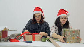 Two designers prepare new year presents for Christmas holidays inside stock video footage