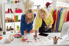 Two designers working on sketch. At their studio Royalty Free Stock Photography