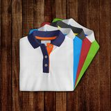 Two designs, T-Shirt mockup, front view. T-Shirt mockup, folded and stacked front view on wooden background stock image