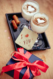 Two desserts and gift on a holiday St. Valentine's Day Royalty Free Stock Photos